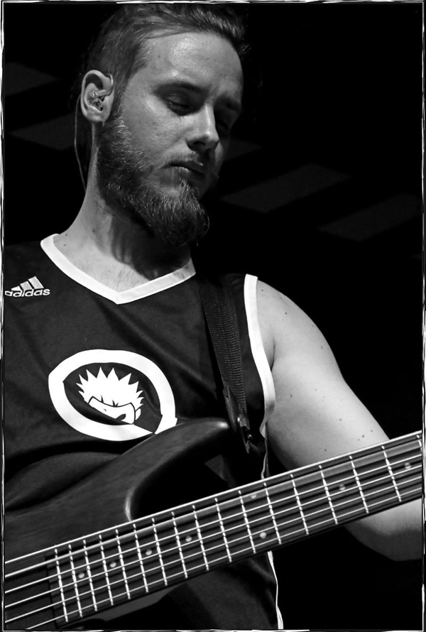 "Click to enlarge the picture of Davide ""Dave"" Castagnone (Bass)"
